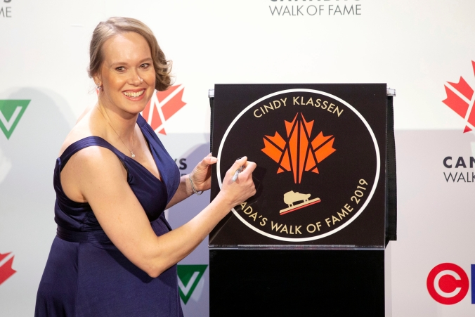 Olympian Cindy Klassen is pictured with her star as she is inducted into Canada's Walk of Fame.