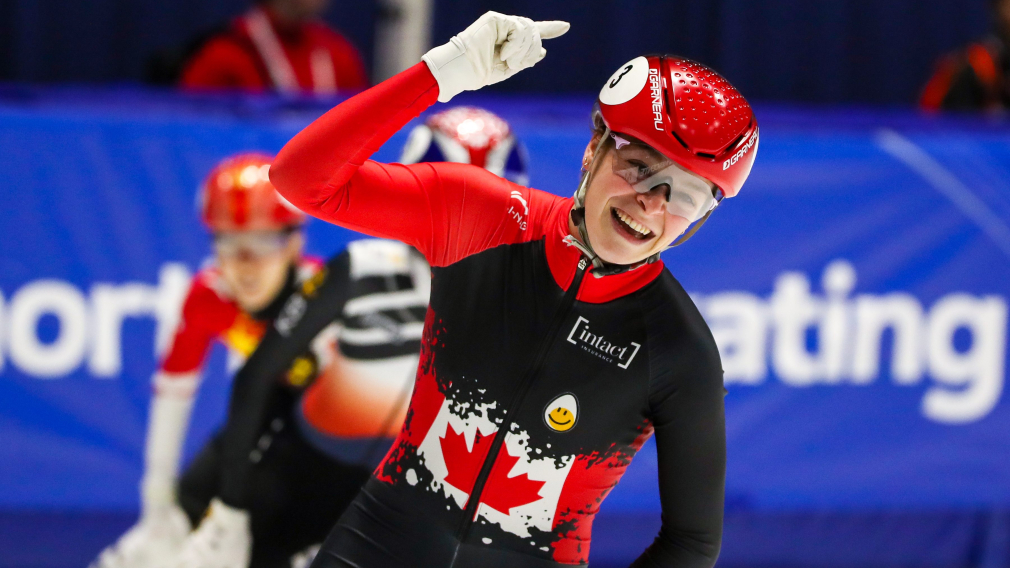 Kim Boutin celebrates as she passes the 1000m finish line at the ISU Short Track World Cup in Montreal