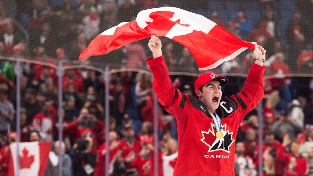 Dillon Dube celebrating with flag