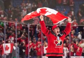 Dillon Dube celebrating with flag
