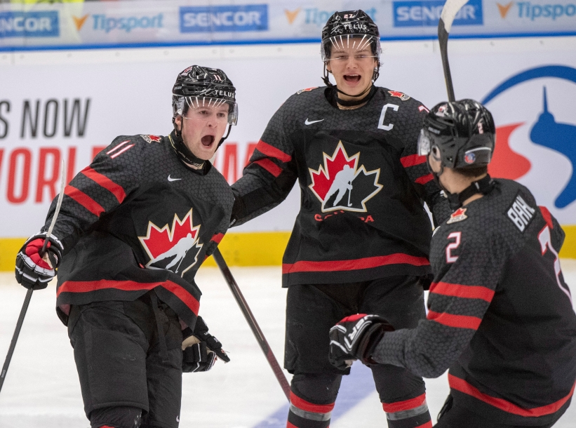 Canada's Alexis Lafreniere, left, celebrates his goal with teammates Barrett Hayton and Kevin Bahl (2) during first period semifinal action against Finland at the World Junior Hockey Championships on Saturday, January 4, 2020 in Ostrava, Czech Republic. THE CANADIAN PRESS/Ryan Remiorz