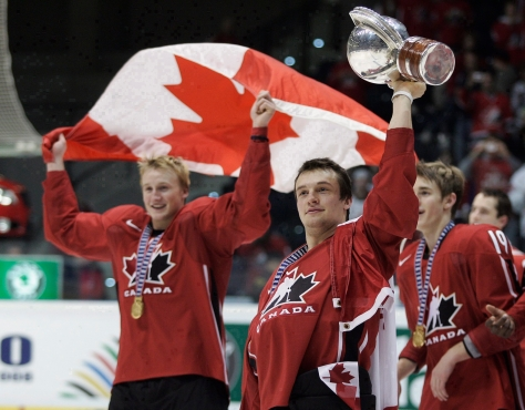 Team Canada players celebrate with flag