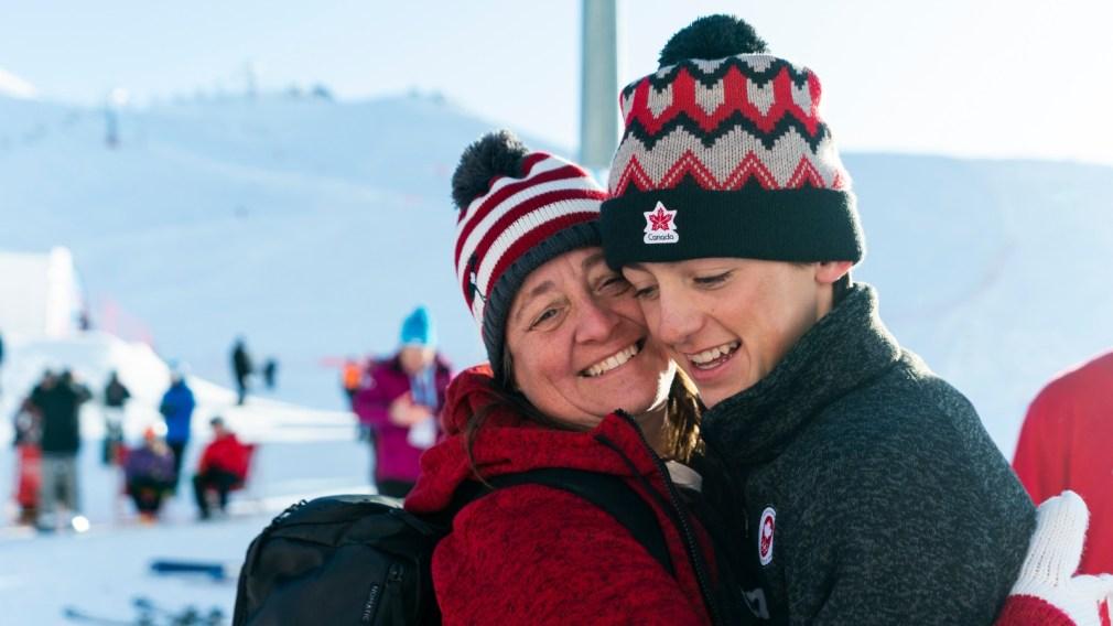 Liam Brearley (right) hugs his mom (left)