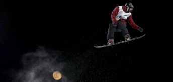 Canada's Darcy Sharpe jumps, backdropped by the moon, in the Men's Snowboard Big Air for the 2019 FIS Big Air World Cup held at the Big Air Shougang in Beijing on Saturday, Dec. 14, 2019. (AP Photo/Ng Han Guan) ///