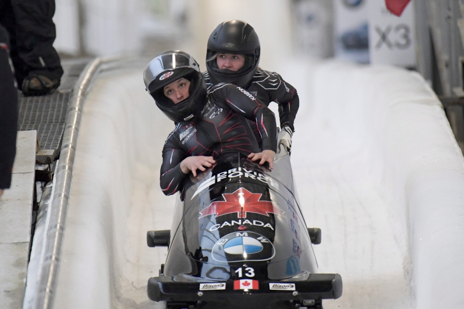 Driver Christine de Bruin, and brakeman Kristen Bujnowski of Canada, finish third place in the women's bobsled World Cup race, in Lake Placid, N.Y., on Saturday, Dec. 14, 2019. (AP Photo/Hans Pennink)