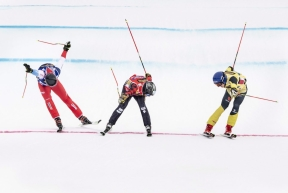 Daniel Bohnacker, yellow, of Germany crosses the finish line to win followed by Kevin Drury, red, of Canada and Ryan Regez, blue, of Switzerland during the FIS World Cup Men's Freestyle Skicross final in Idre, Sweden, on Sunday Jan. 26, 2020. (Pontus Lundahl / TT via AP)