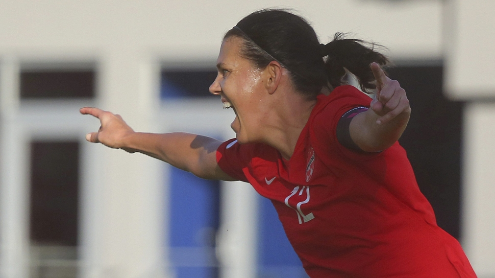 Canada's Christine Sinclair celebrates after scoring.