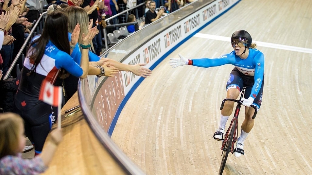 Canadian cyclist Kelsey Mitchell reaches out for fans hand