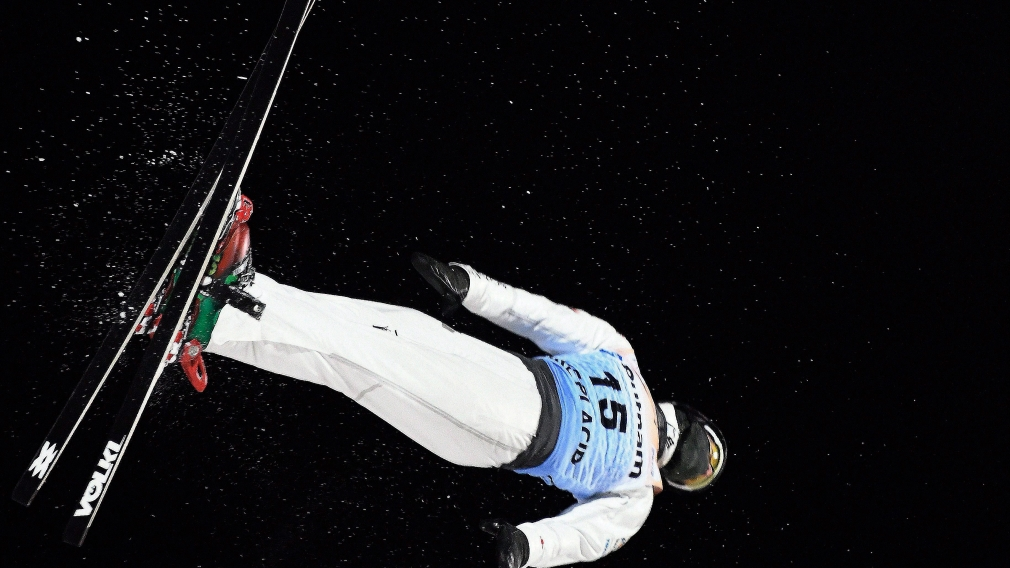 Lewis Irving, of Canada, competes in the men's World Cup freestyle skiing aerials in Lake Placid, N.Y., Saturday, Jan. 20, 2018. (AP Photo/Hans Pennink)
