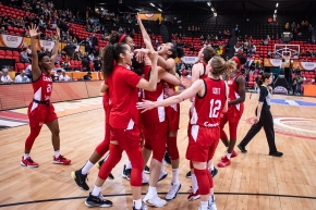 Team Canada basketball players celebrates their win at the FIBA Women's Olympic Qualifying Tournament