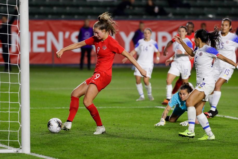 Canada forward Jordyn Huitema scores against Costa Rica.