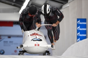 Justin Kripps and Benjamin Coakwell of Canada start their first run of the two-man Bobsled World Cup race