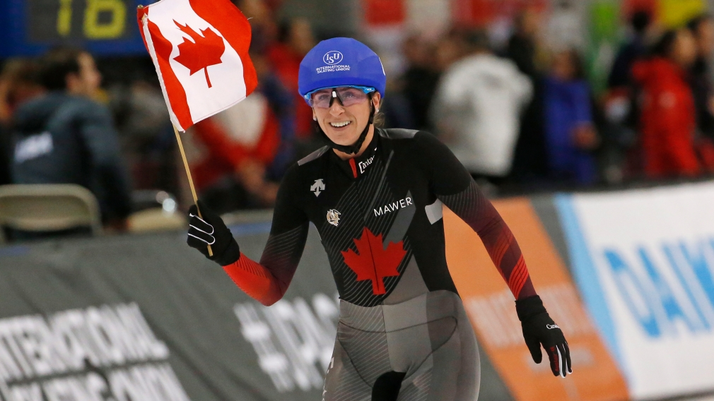 Canada's Ivanie Blondin celebrates after competing in the women's mass start