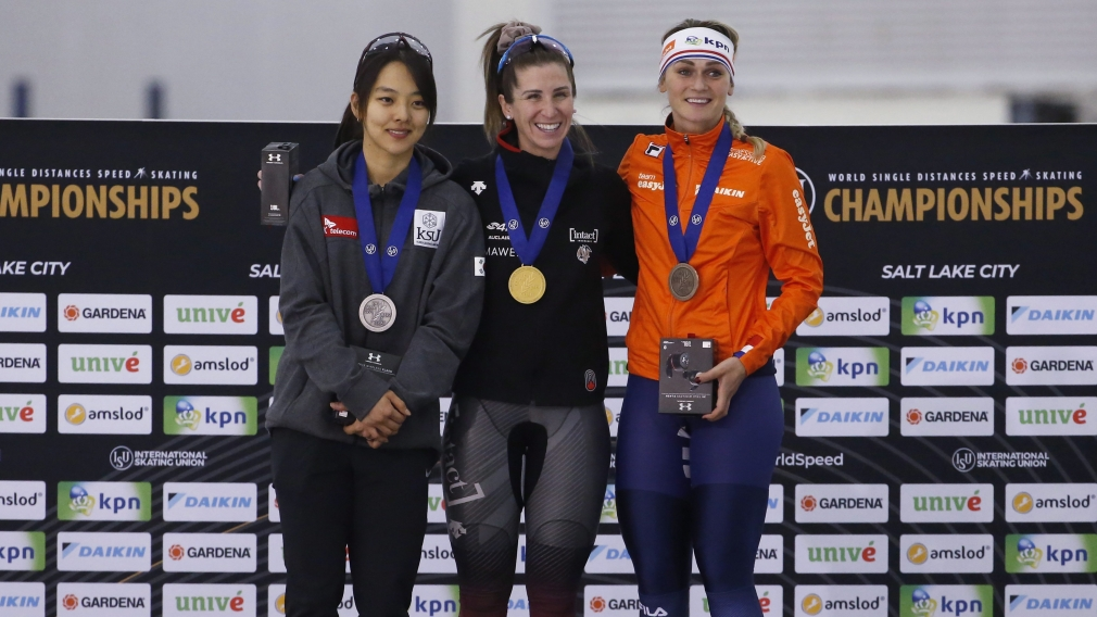 Speed skating medallists stand on podium after competing in women's mass start