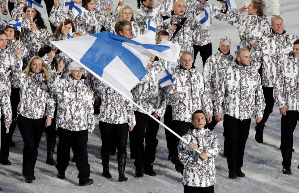 Finland's Ville Peltonen carries the flag during the opening ceremony for the Vancouver 2010 Olympics in Vancouver, British Columbia, Friday, Feb. 12, 2010.