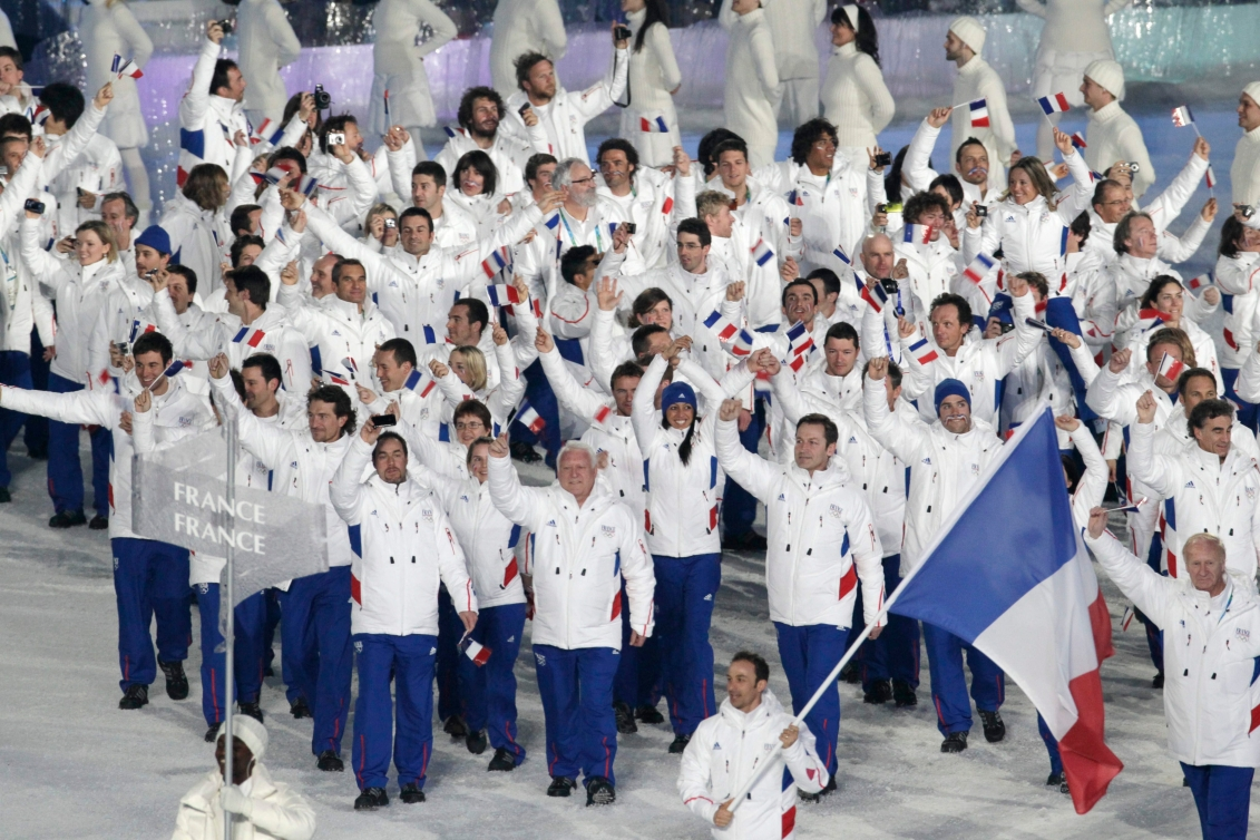 France's Vincent Defrasne carries the flag during the opening ceremony for the Vancouver 2010 Olympics in Vancouver, British Columbia, Friday, Feb. 12, 2010.