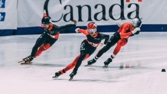 Speed skaters compete in the men's relay