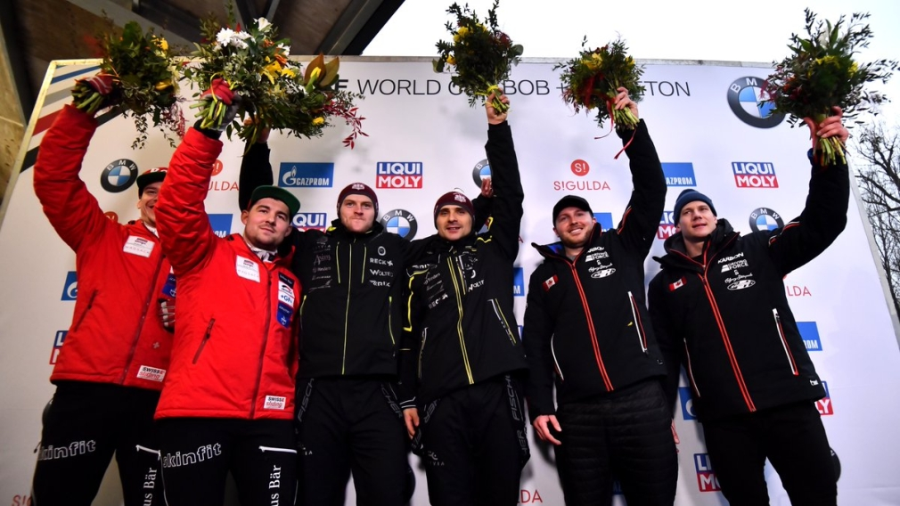 Bobsled medallists stand on the podium at the World Cup in Latvia