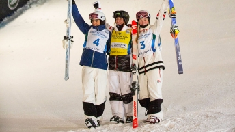 Justine Dufour-Lapointe (right) poses with winner Perrine Laffont (centre) and silver medallist Jakara Anthony.