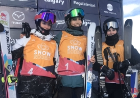 Slopestyle medallists stand on the podium after competing in the women's freestyle skiing event.