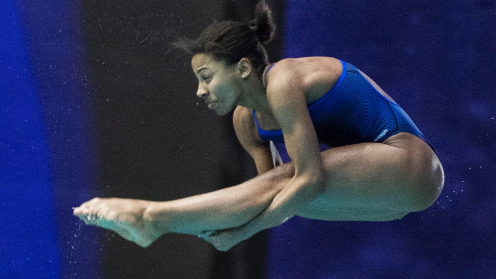 Jennifer Abel of Canada performs a dive during the women's 3-metre springboard final at the FINA Diving World Series in Montreal, Sunday, March 1, 2020. THE CANADIAN PRESS/Graham Hughes