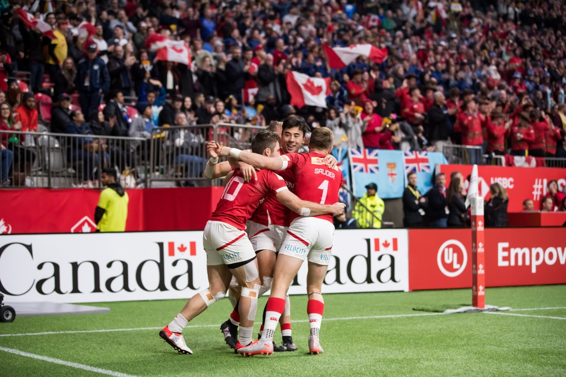 A group of Canadian rugby players celebrate a win