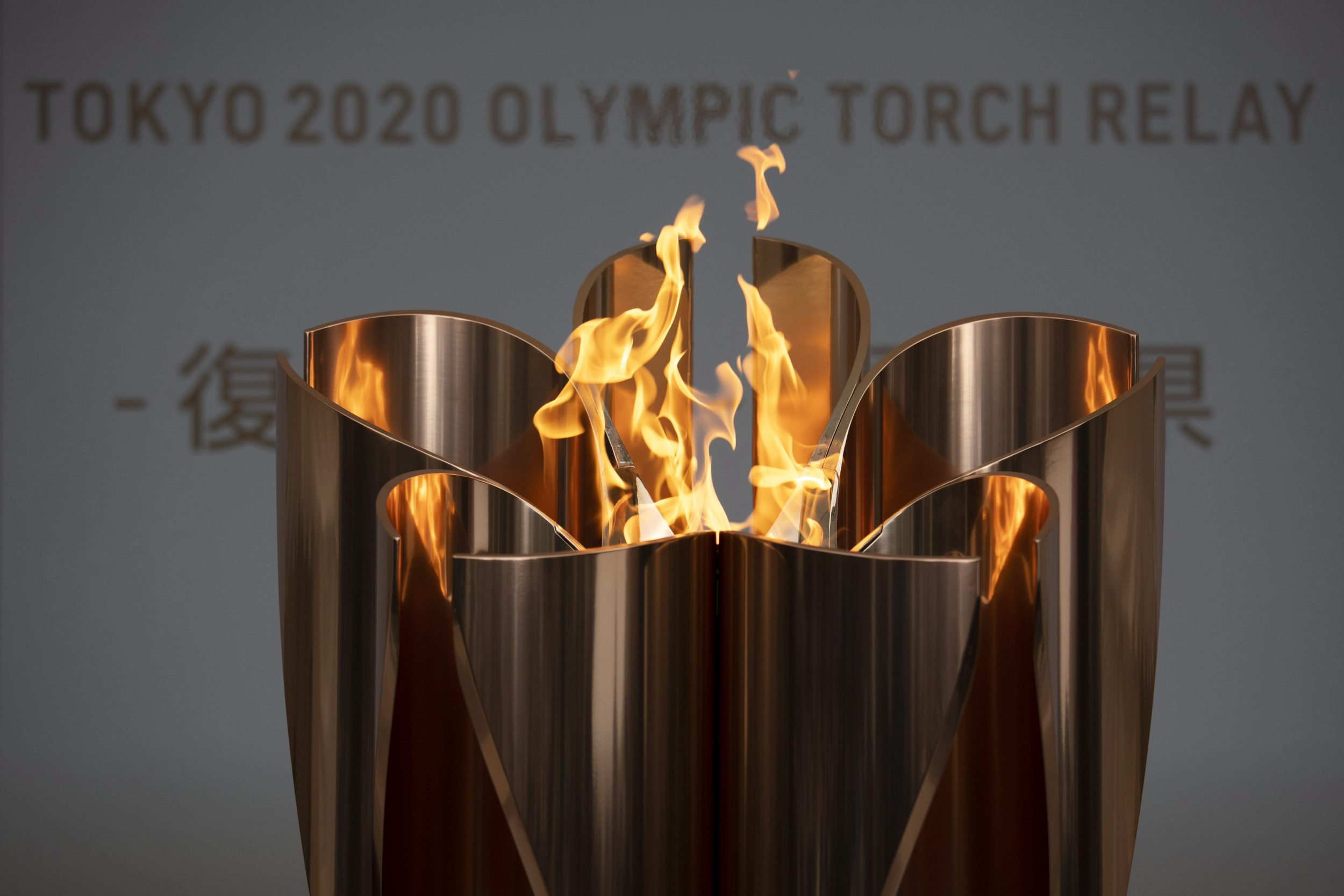 The Tokyo 2020 Olympic flame burns during the postponement of the Games