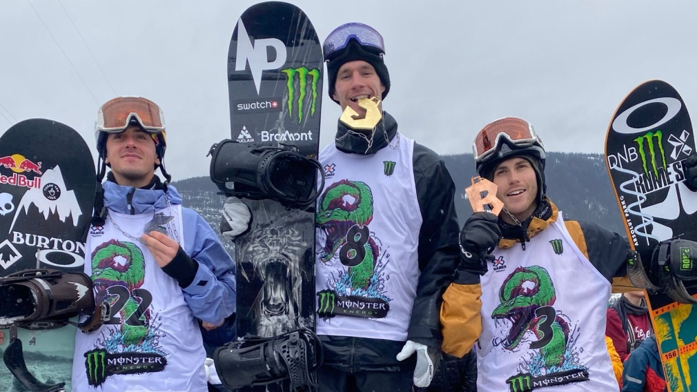 Slopestyle snowboard medallists stand on the podium including Max Parrot and Mark McMorris.