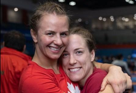 Erica Wiebe (left) and Danielle Lappage hug.