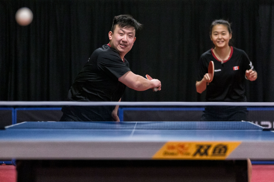 Eugene Wang (left) and Mo Zhang compete during the ITTF North American qualifier.