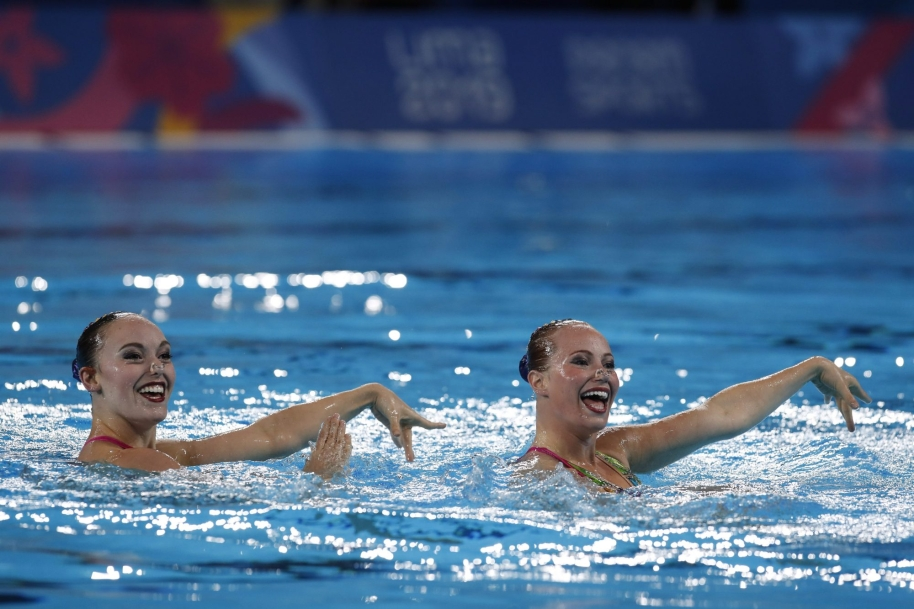 Jacqueline Simoneau and Claudia Holzner, of Canada, compete to win the gold medal in the artistic swimming duet technical routine final at the Pan American Games in Lima, Peru, Wednesday, July 31, 2019.