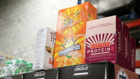 Snacks to be donated to Moisson Montréal (L-R Box of God Things, box of Maynards Peach Fuzzies, Larabar protein bars.
