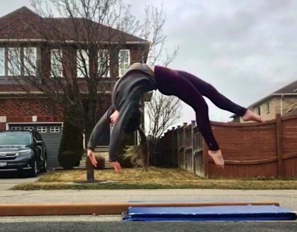 Ana Padurariu trains on a beam in front of her house