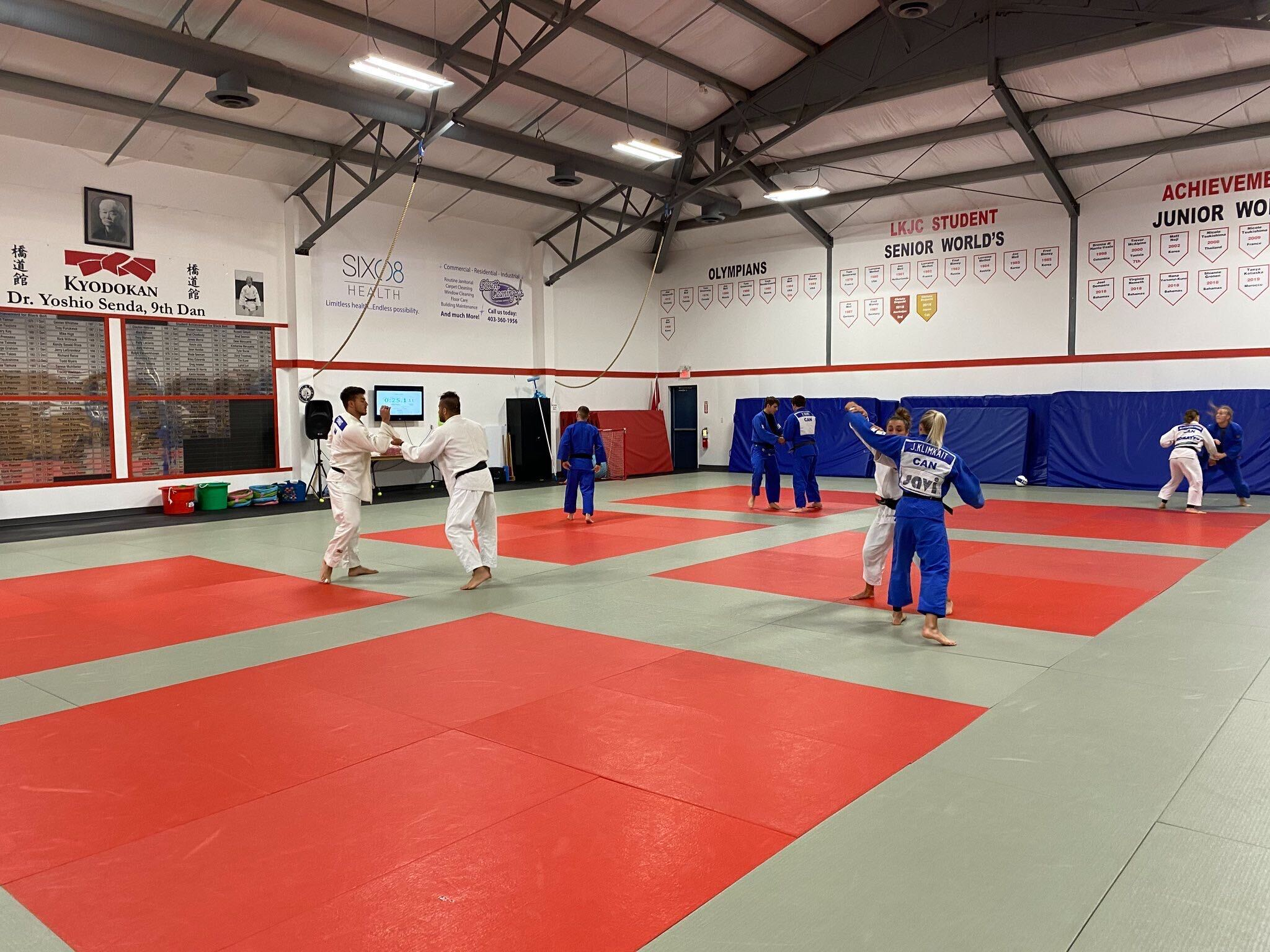 Judo team members practice in a dojo
