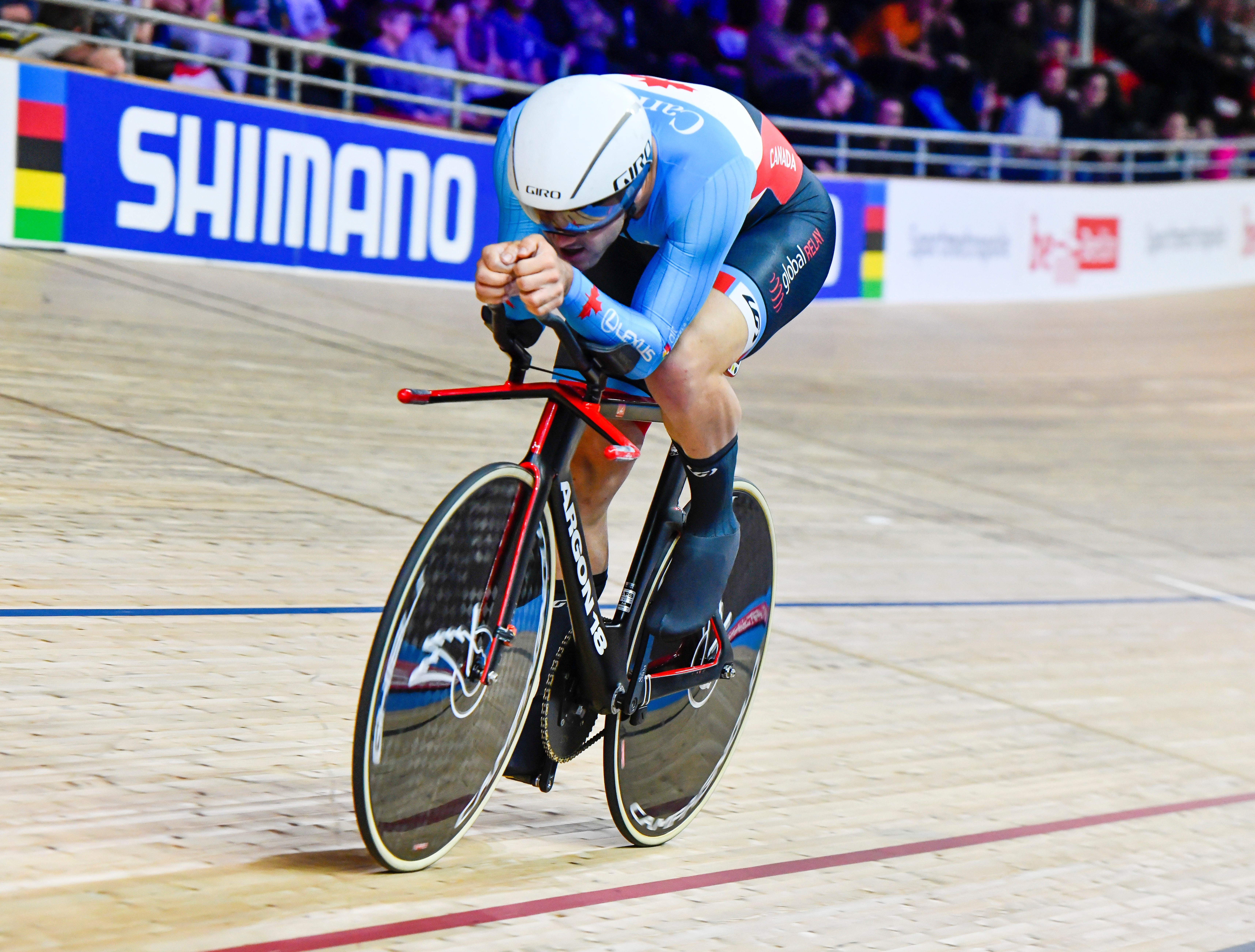 Vincent de Haitre racing on bike in velodrome