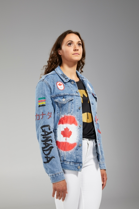 Kylie Masse is facing the camera in Tokyo 2020 closing ceremony jean jacket