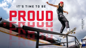 """Annie Guglia skateboarding down a rail with the words """"It's Time to Be Proud"""" behind her."""