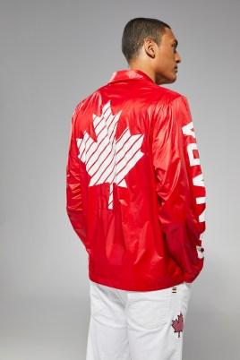 LePage back towards screen with jacket on. Showing maple leaf on back of jacket