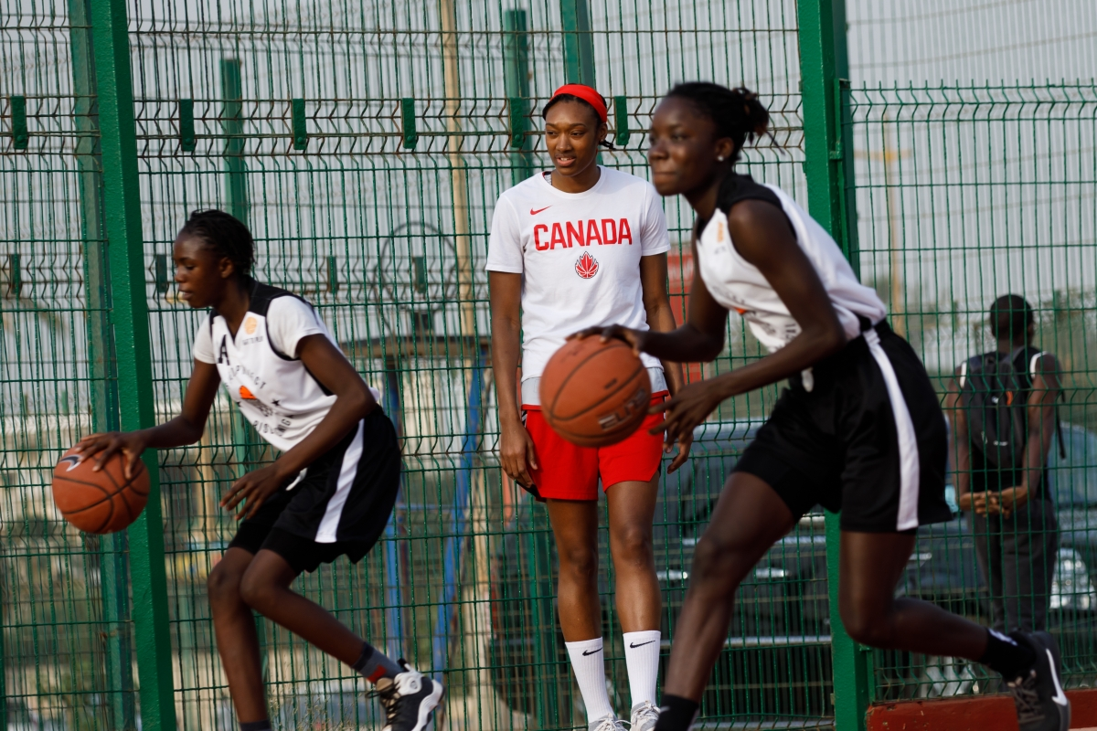 Kayla Alexander plays basketball with girls in Senegal