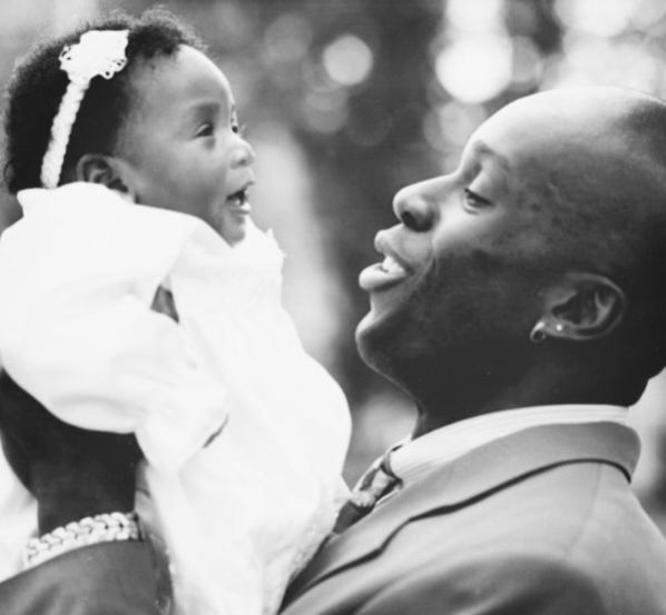 Bruny Surin holds baby daughter Katherine