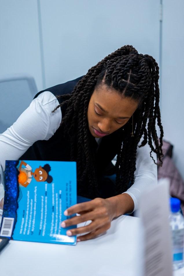 Kayla Alexander signing her book