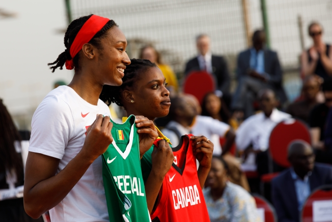 Kayla Alexander poses with a Senegal basketball jersey