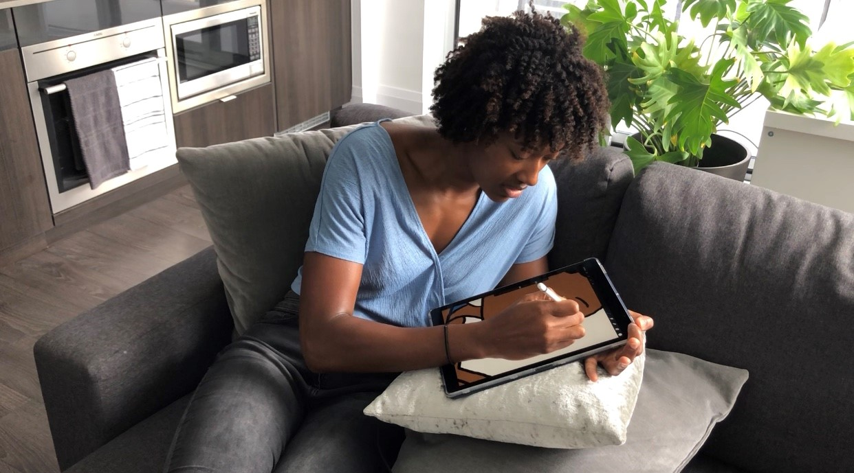 Kayla Alexander drawing on her tablet
