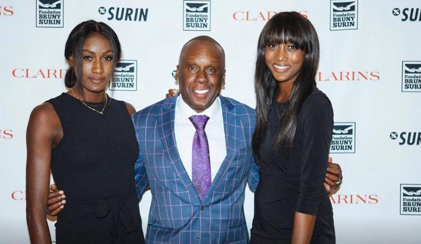 Bruny Surin poses with his two daughters