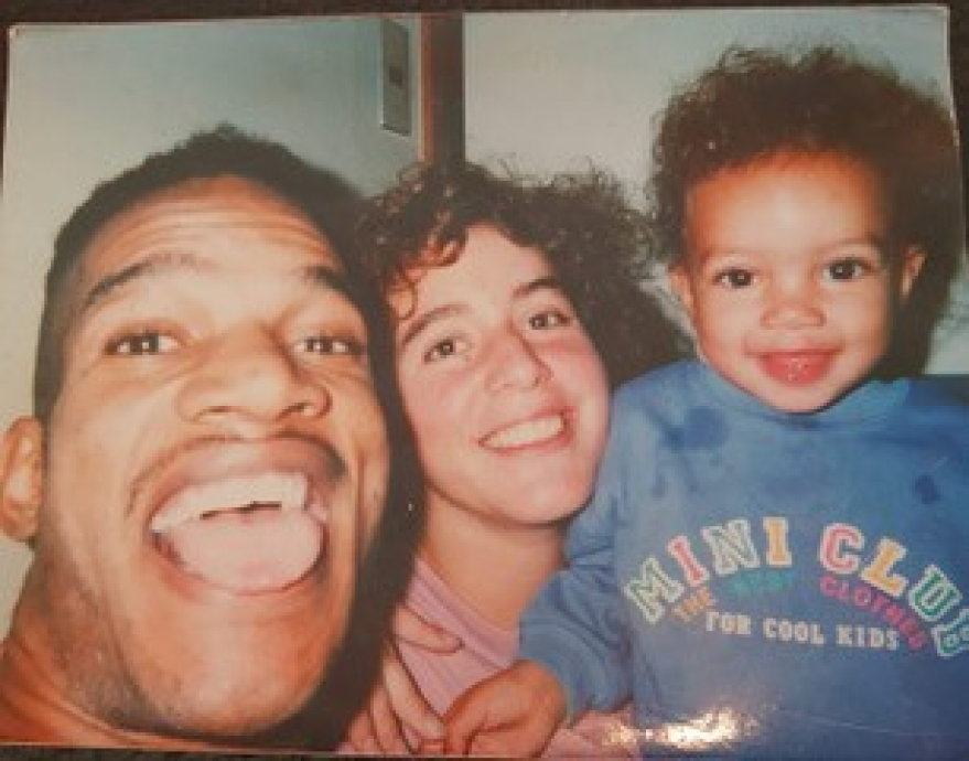 A young Brandie Wilkerson takes a photo with her parents