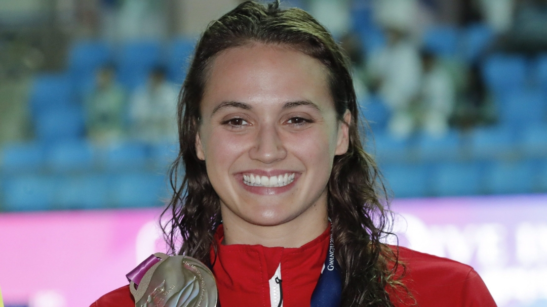 Kylie Masse holds gold medal