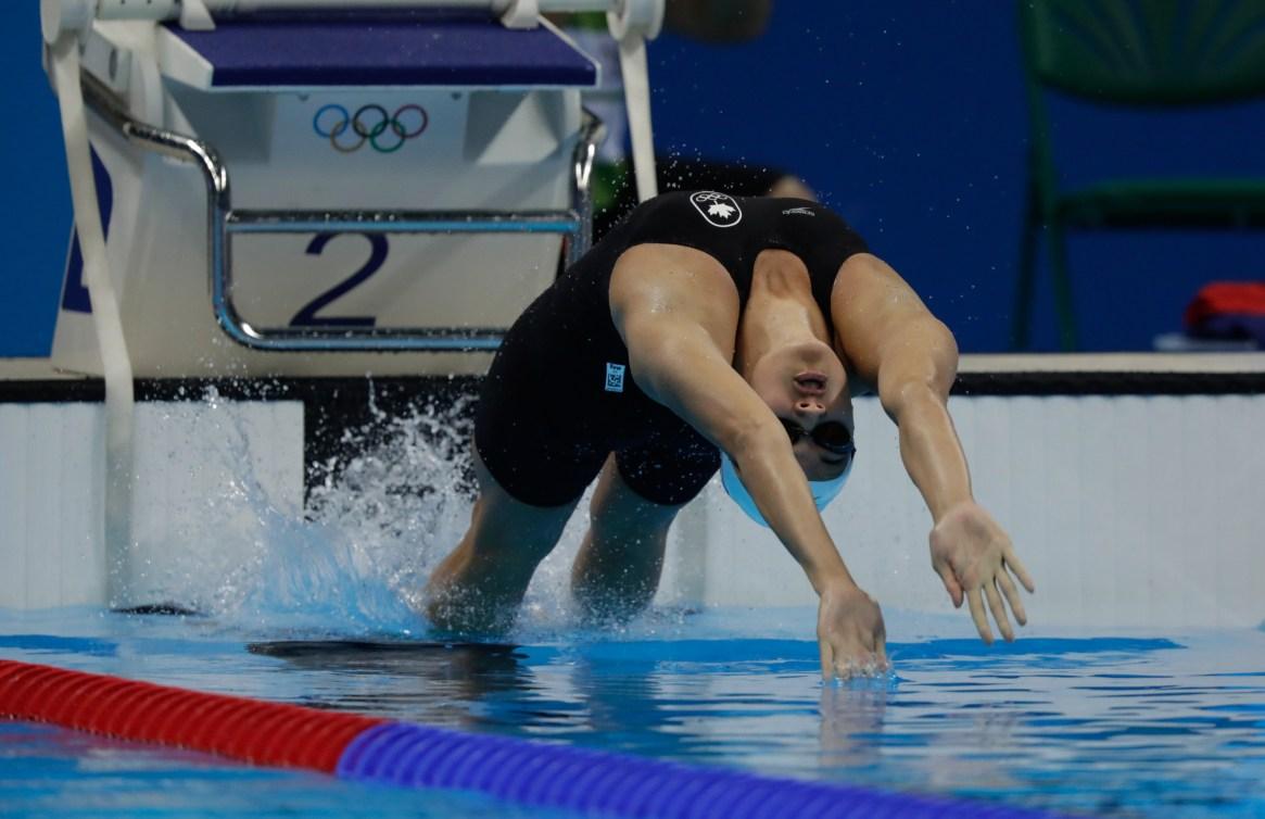Kylie Masse starting a backstroke race
