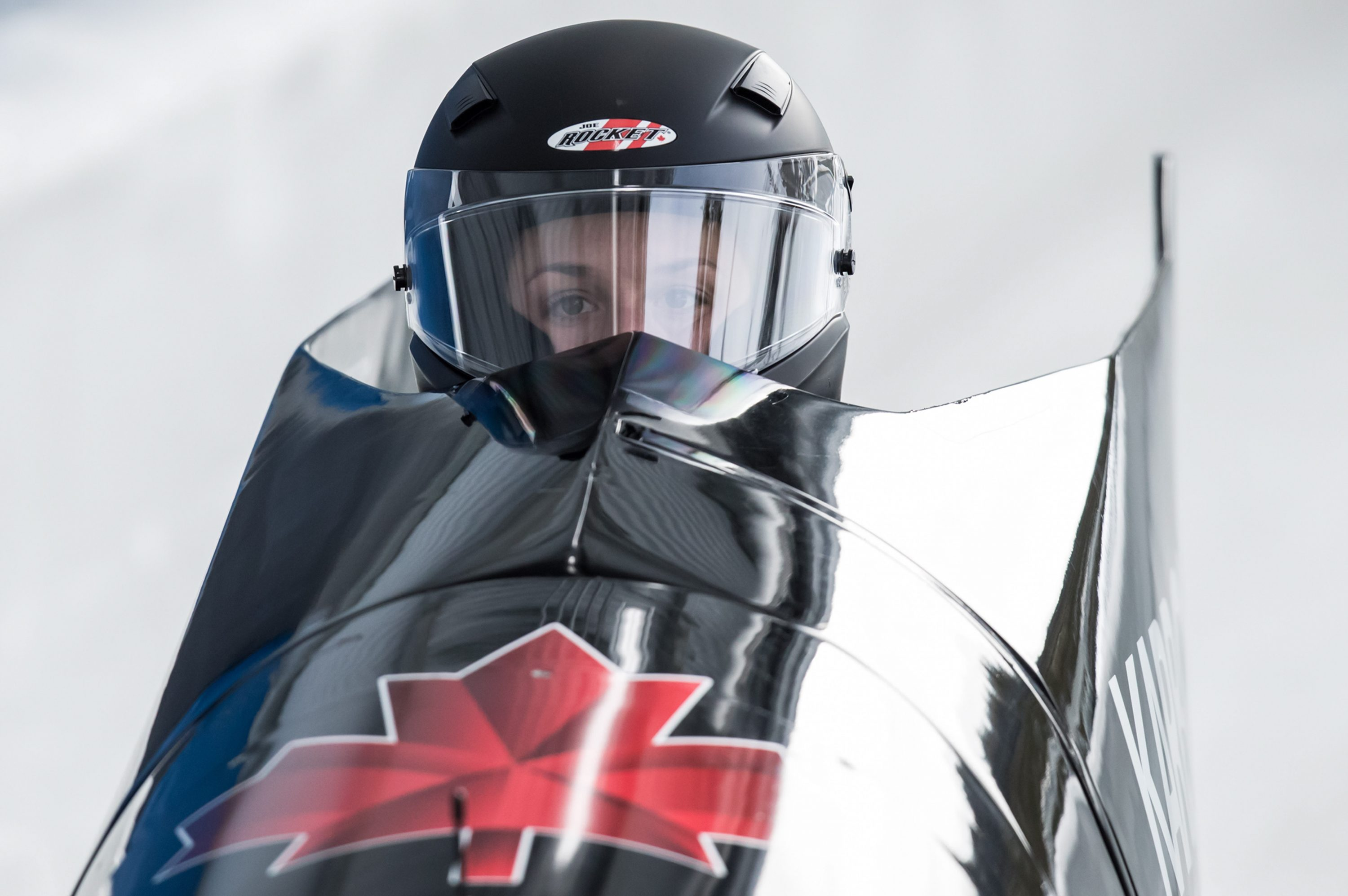 Close up of bobsleigh pilot Christine de Bruin in her sled