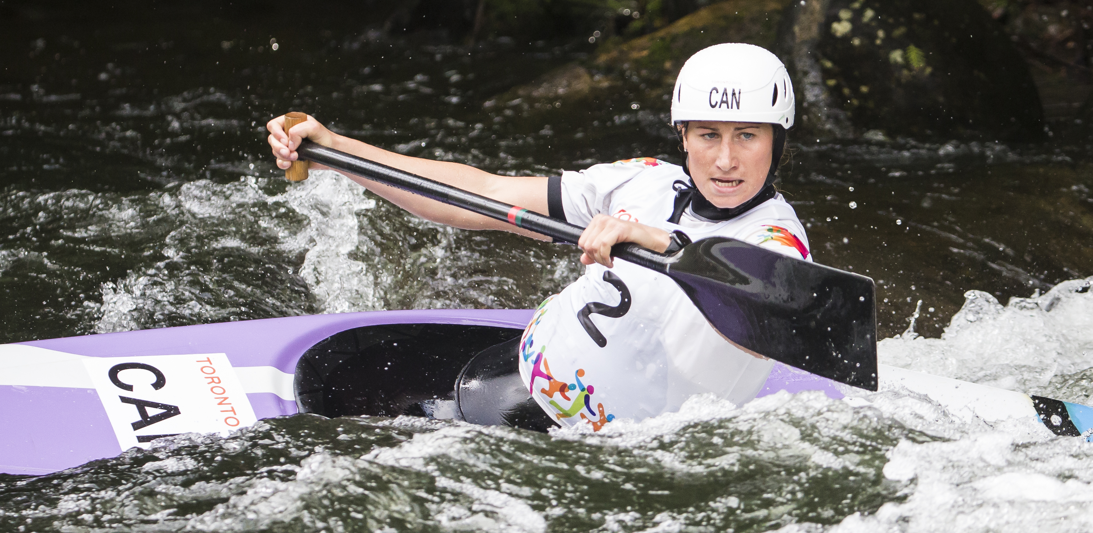 Haley Daniels paddles her slalom canoe through whitewater