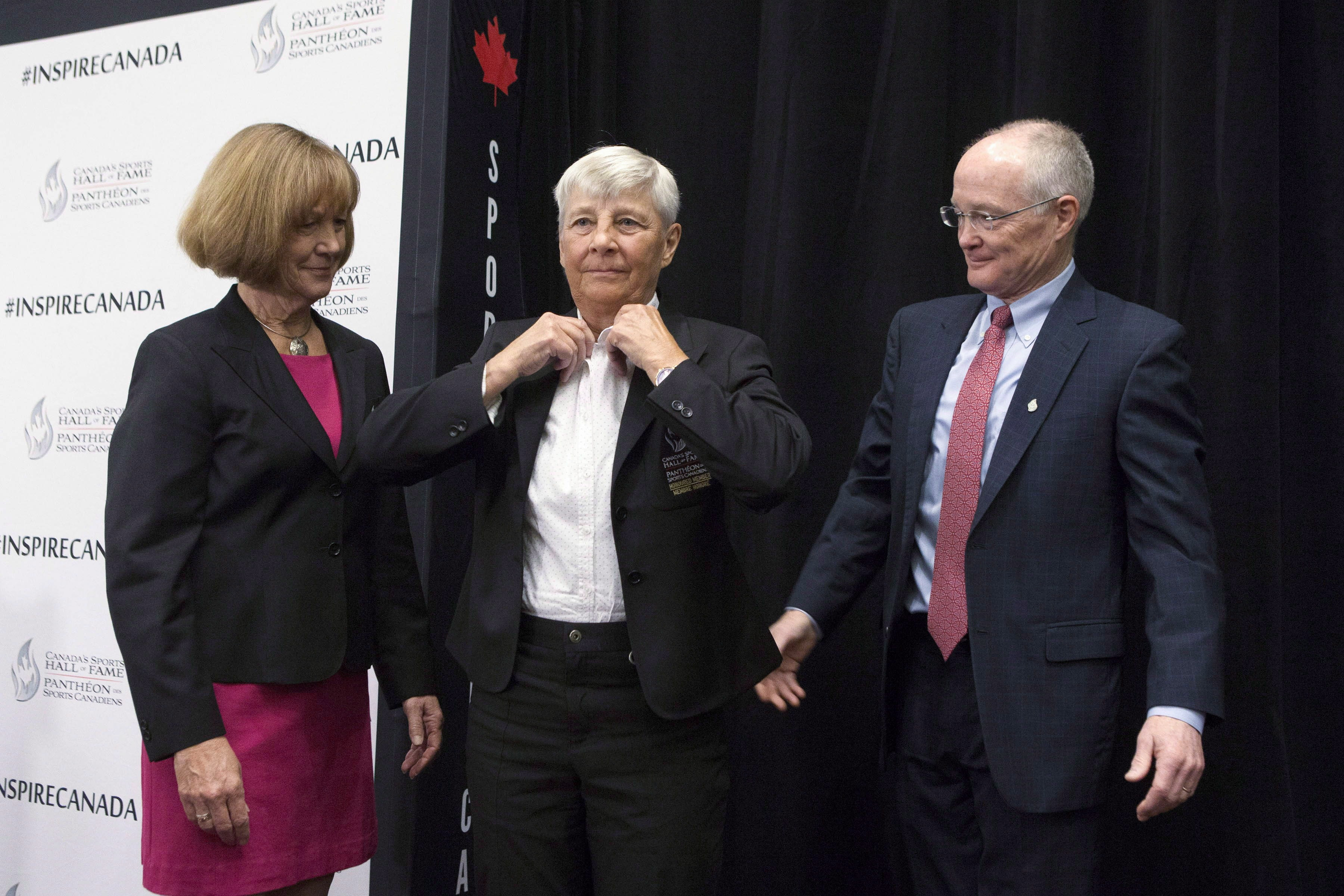 Sandra Kirby adjusts her blazer upon induction to Canada's Sports Hall of Fame
